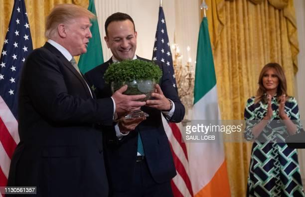 Irish Prime Minister Leo Varadkar presents a bowl of shamrocks to US President Donald Trump alongside US First Lady Melania Trump during a Shamrock...