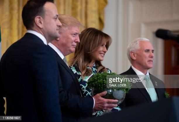 Irish Prime Minister Leo Varadkar presents a bowl of shamrocks to US President Donald Trump alongside US First Lady Melania Trump and US Vice...