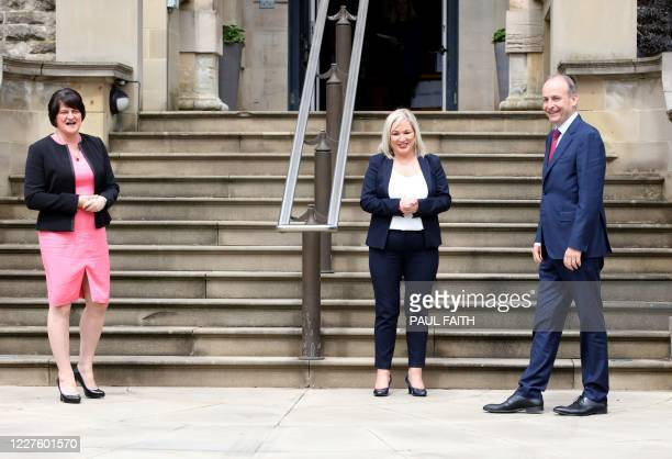 Irish Prime Minister Micheal Martin is greeted by Northern Ireland's First Minister Arlene Foster and Deputy First Minister Michelle O'Neill at...