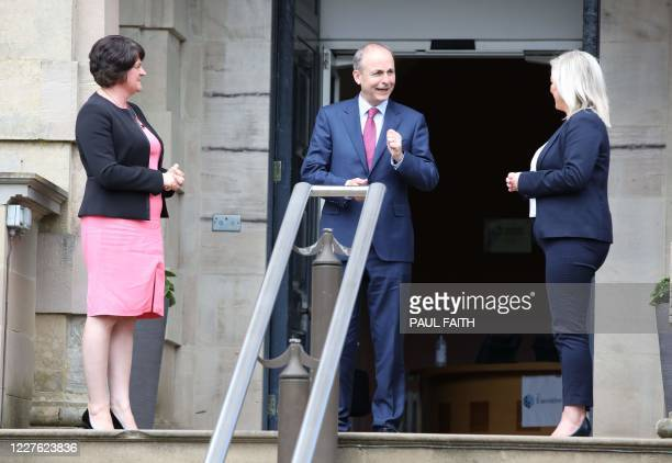 Irish Prime Minister Micheal Martin leaves after meeting with Northern Ireland's First Minister Arlene Foster and Deputy First Minister Michelle...