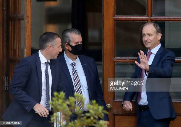 Irish Prime Minister Micheal Martin waves off Democratic Unionist Party leader Edwin Poots and Democratic Unionist Party MLA Paul Givan as they leave...