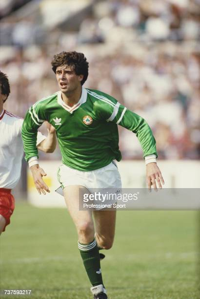 Irish professional footballer and forward with Arsenal Niall Quinn pictured in action for the Republic of Ireland national football team during an...