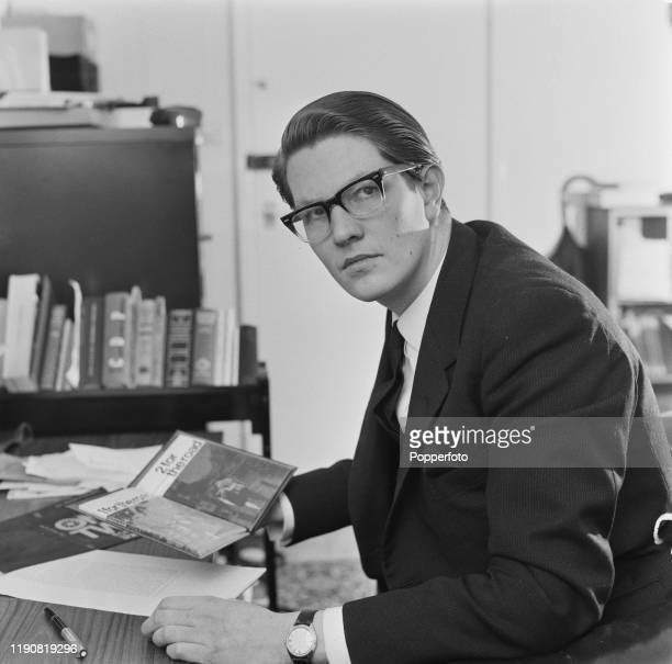 Irish publisher and literary agent Colin Smythe seated at a desk in an office in April 1967