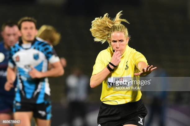 TOPSHOT Irish referee Joy Neville blows a whistle during the European Challenge Cup rugby match between BordeauxBegles and Yenisei on December 15...