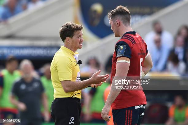 Irish referee JP Doyle speaks to Munster's Irish flanker Billy Holland during the European Champions Cup semifinal rugby union match between Racing...