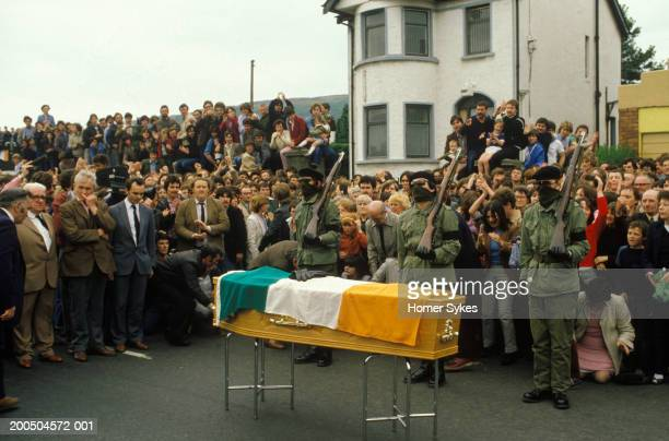 Irish republican Army funeral IRA soldiers act as honour guard and fire their rifles over the coffin