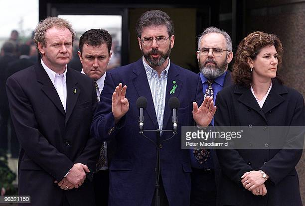 Irish Republican politician Gerry Adams and the Sinn Fein delegation speak to the press on their way into the talks at Stormont 1st July 1999 On the...