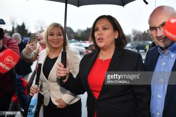 Irish republican Sinn Fein party leader Mary Lou McDonald arrives with Deputy First Minister Sinn Fein's northern leader Michelle O'Neill at the...