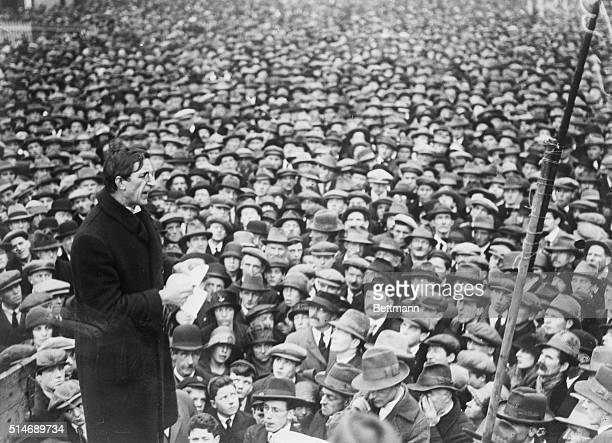 Irish revolutionary leader Eamon de Valera reading from notes addresses a huge crowd of Dubliners during his years as Prime Minister of Ireland De...