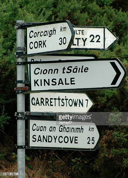 irish road and directional sign listing several irish towns - county cork stock pictures, royalty-free photos & images