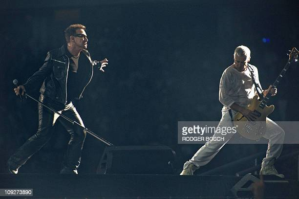 Irish rock band U2 lead singer Bono and U2 bass player Adam Clayton perform during their concert on February 18 2011 at the Green Point stadium in...