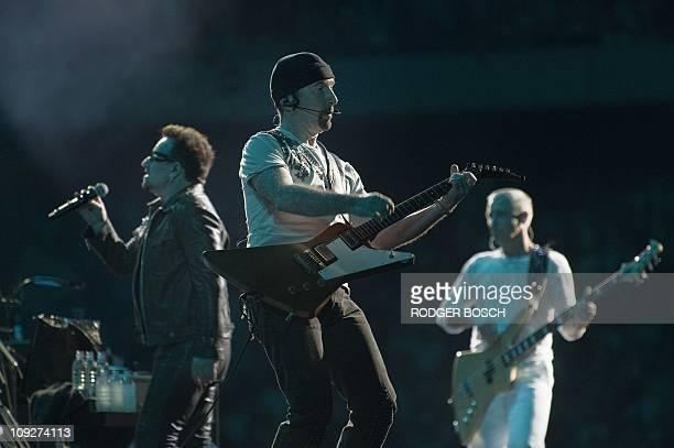 Irish rock band U2 lead singer Bono U2 lead guitar The Edge and bass guitar player Adam Clayton perform during their concert on February 18 2011 at...