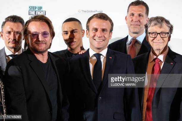 Irish rock band U2 singer Bono , French fashion designer Olivier Rousteing , French President Emmanuel Macron and US Microsoft founder, Co-Chairman...