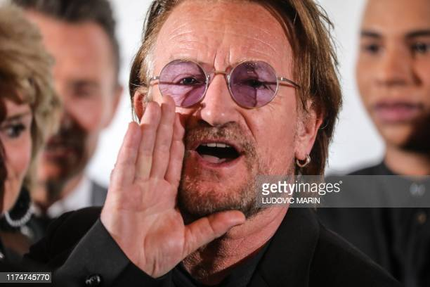 Irish rock band U2 singer Bono gestures at Lyon's city hall, central eastern France, on October 9 during the funding conference of Global Fund to...