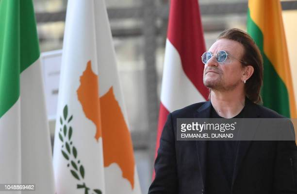 Irish rock band U2 singer Bono looks up upon his arrival at the European Council in Brussels on October 10 2018 Bono the cofounder of ONE a global...