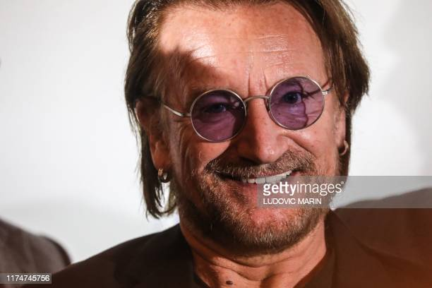 Irish rock band U2 singer Bono poses for a picture at Lyon's city hall, central eastern France, on October 9 during the funding conference of Global...