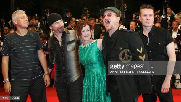 Irish rock band U2's lead singer Bono shouts early 20 May 2007 as he poses with fellow band members British bass player Adam Clayton British guitar...