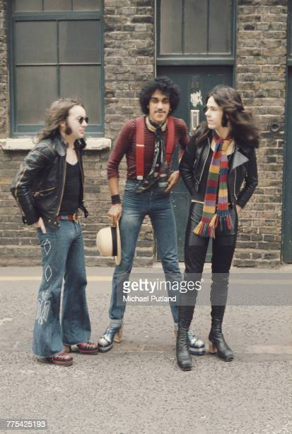 Irish rock group Thin Lizzy posed together in a street in London 1974 Left to right Brian Downey Phil Lynott and Gary Moore