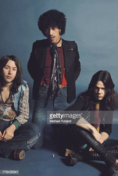 Irish rock group Thin Lizzy posed together in a studio in London 1974 Left to right drummer Brian Downey bass guitarist Phil Lynott and guitarist...