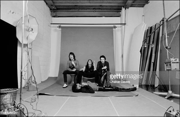 Irish rock group Thin Lizzy posing in a photo studio in Paris for their LP 'Black Rose' 1979 Left to right Gary Moore Scott Gorham Brian Downey Phil...