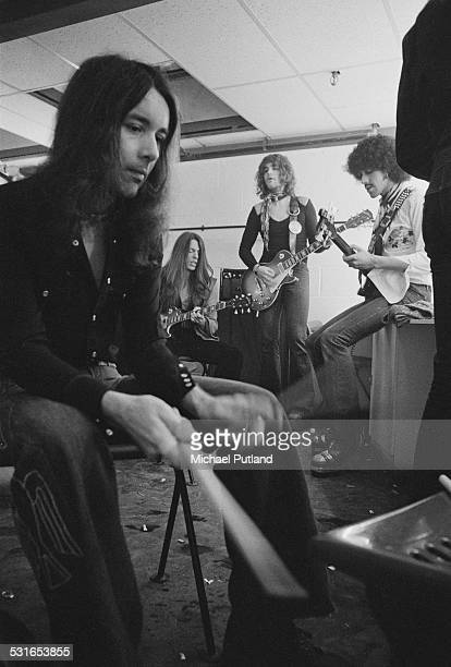 Irish rock group Thin Lizzy rehearsing backstage in a dressing room at the Roundhouse London 3rd November 1974 Left to right drummer Brian Downey...