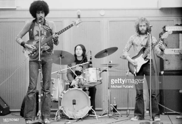 Irish rock group Thin Lizzy rehearsing in London 1973 Left to right bassist and singer Phil Lynott drummer Brian Downey and guitarist Eric Bell