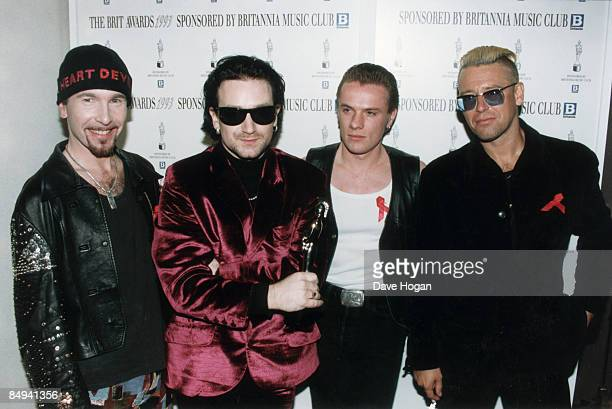Irish rock group U2 at the BRIT Awards London 1993 Left to right The Edge Bono Larry Mullen Jr and Adam Clayton