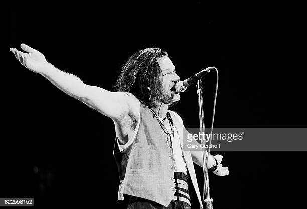 Irish Rock musician Bono of the group U2 performs onstage at Giants Stadium durign the band's 'Joshua Tree' tour East Rutherford New Jersey September...