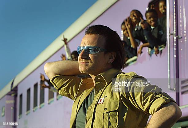 Irish rocker Bono lead singer of U2 is pictured at the Love Life Train in Soweto township 24 May 2002 outside Johannesburg He was visiting the clinic...
