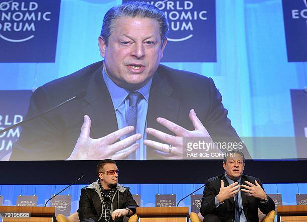 Irish rocker Bono listens as former US vice president and Nobel laureate Al Gore talks during a session at the World Economic Forum in Davos in 24...