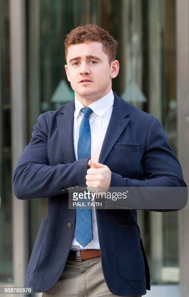 Irish rugby player Paddy Jackson leaves court in Belfast on March 27 2018 as the jury deliberates on its verdict in the trial in which he is accused...