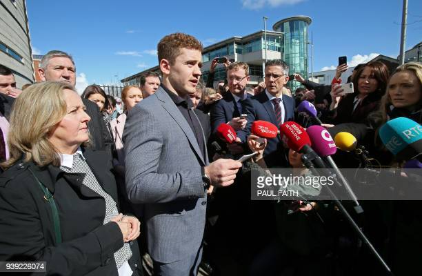 Irish rugby player Paddy Jackson speaks to members of the media as he leaves court in Belfast on March 28 after being found not quilty of a charge of...