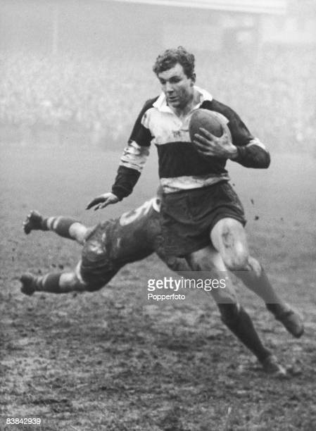 Irish rugby player Tony O'Reilly of Barbarians FC evades a tackle by Alan Morton of the Australia national rugby union team or 'Wallabies' during a...