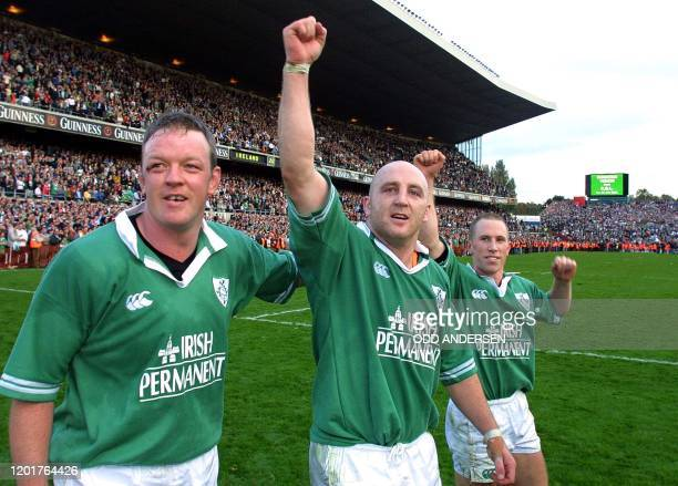 Irish Rugby Union captain Keith Wood flanked by teammates Peter Stringer and Michael Galwey celebrates their win over England after a Six Nation...