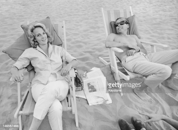 Irish screenwriter producer and director Kevin McClory with his future wife Frederica 'Bobo' Sigrist on a beach during the Venice Film Festival 27th...