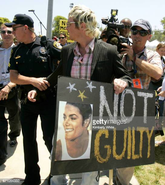 Irish Sean O'Kane a supporter of pop singer Michael Jackson is briefly taken away by police for creating a disturbance at the Santa Barbara County...