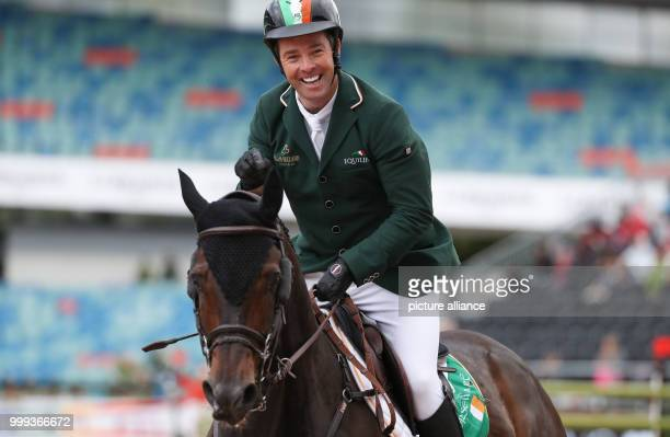 Irish show jumper Cian O'Connor on his horse Good Luck during the Show Jumping Team Event of the FEIEuropean Championships 2017 in Gothenburg,...