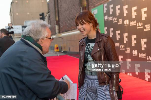 Irish singer and actress Jessie Buckley signs autograph and talks to fans at the UK Premiere of 'Beast' during the 14th Glasgow Film Festival at...
