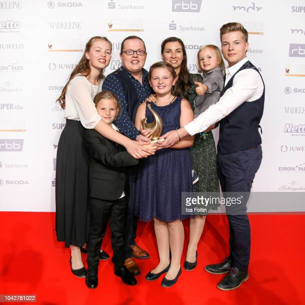 Irish singer and award winner Angelo Kelly with his wife Kira Harms Kelly and their kids during the Goldene Henne winners board photo call on...