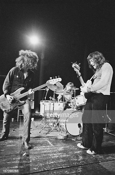 Irish singer and guitarist Rory Gallagher performing with bassist Gerry McAvoy and drummer Wilgar Campbell at the Roundhouse Camden London 4th May...