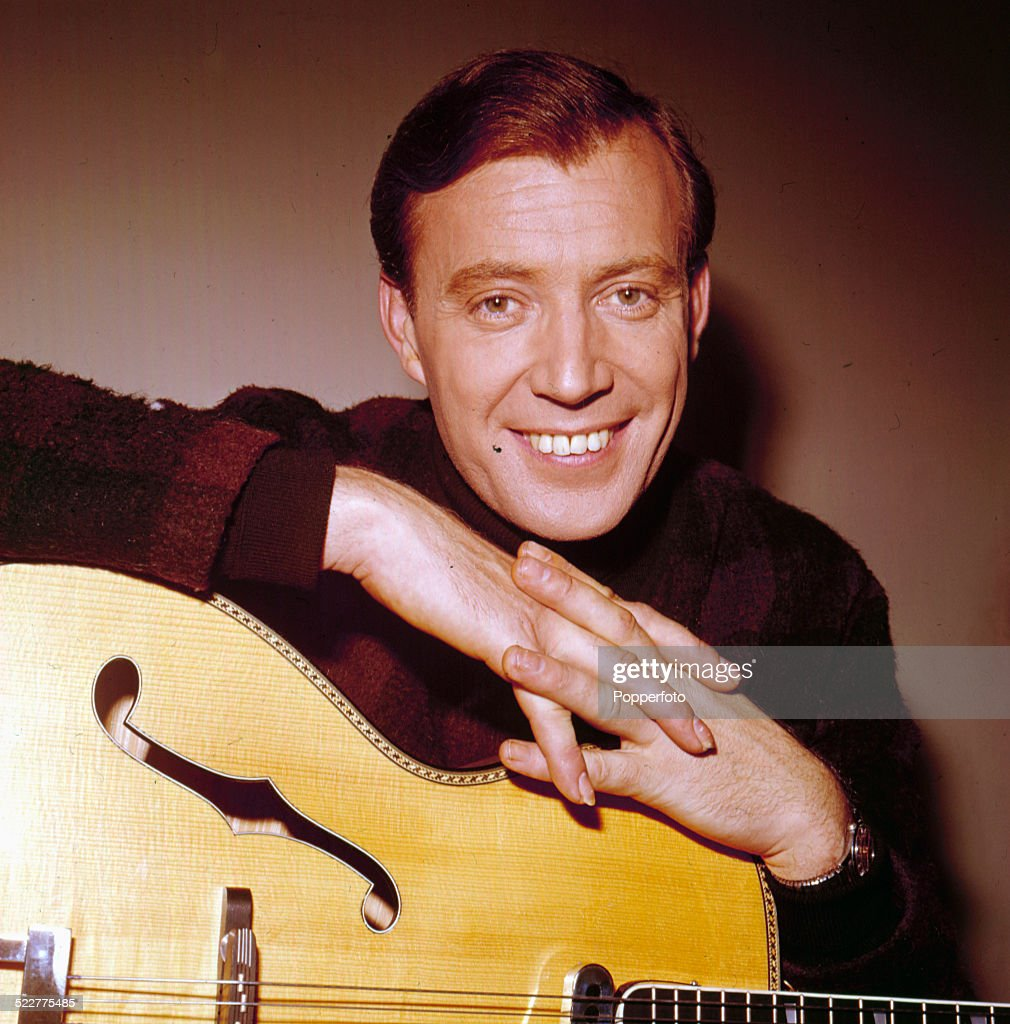 Irish singer and guitarist Val Doonican posed with his guitar in 1964.
