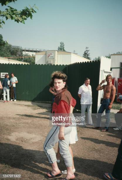 Irish singer and songwriter Bono of rock band U2 at a music event, June 1983.