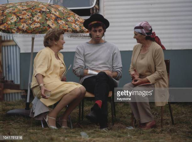 Irish singer Bob Geldof of The Boomtown Rats with his mother and another relative at Castlebar County Mayo Ireland circa 1980