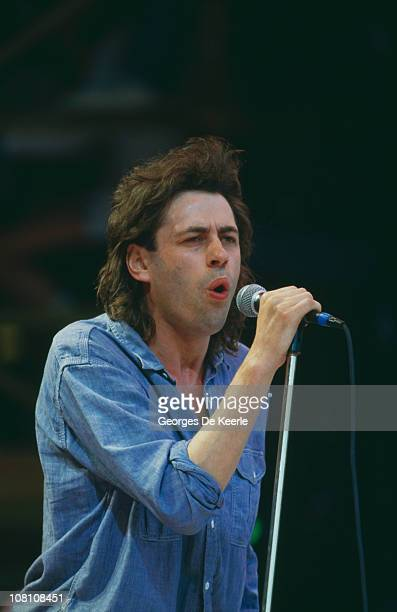 Irish singer Bob Geldof performs at the Live Aid concert at Wembley Stadium in London 13th July 1985 The concert raised funds for the famine in...