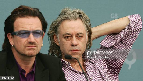 Irish singer Bono and singer Bob Geldof are seen during a press briefing at the end of the G8 summit on July 8, 2005 in Gleneagles. World leaders...