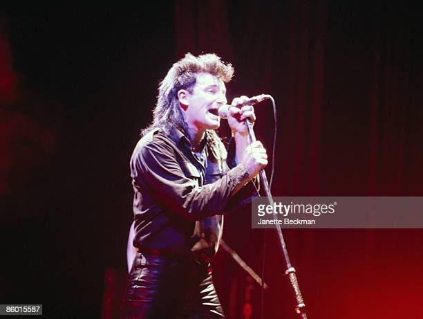 Irish singer Bono from the band U2 performs on stage at Radio City Music Hall New York New York December 3 1985
