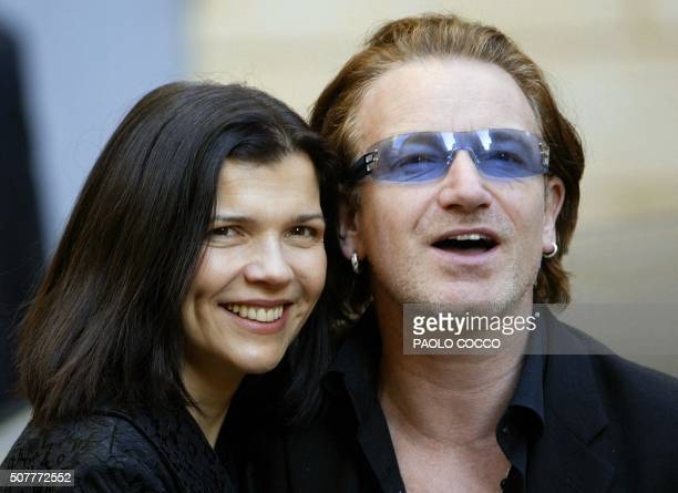 Irish singer Bono lead singer of the rock group U2 smiles flanked by his wife Alison Stewart after attending the wedding of famous Italian tenor...