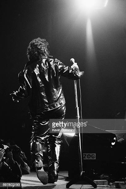 Irish singer Bono performing in Paris with rock group U2 during the band's Zoo TV tour May 1992