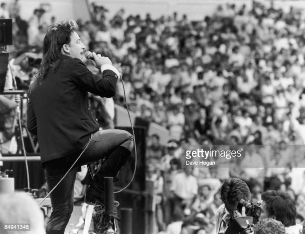 Irish singer Bono performing with U2 at the Live Aid charity concert Wembley Stadium London 13th July 1985