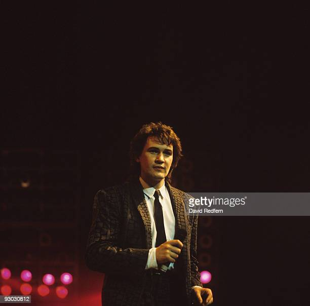 Irish singer Johnny Logan performs on stage in the 1980's